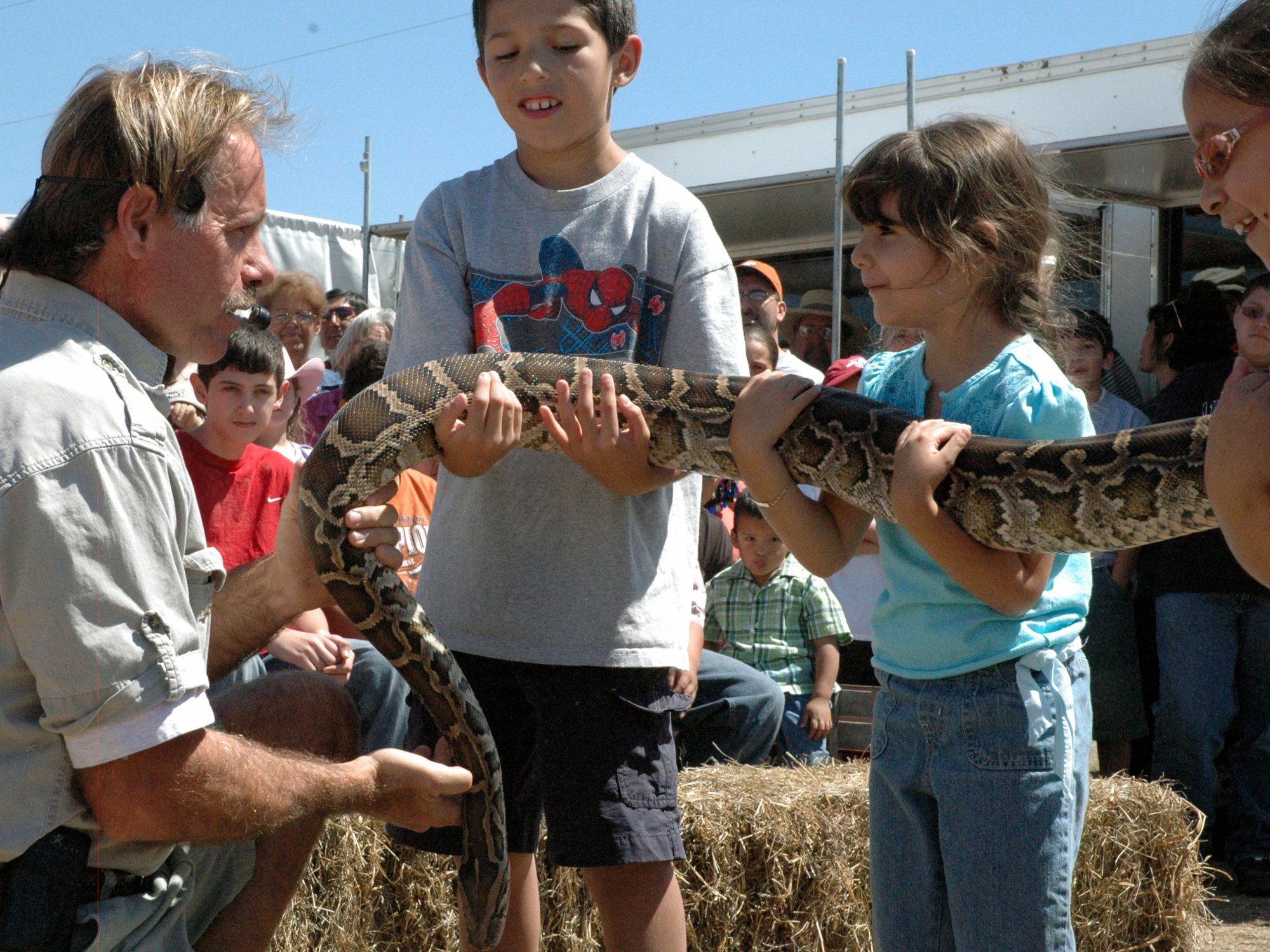 Big Event Reptile Adventures Expert showing a snake to Students at show