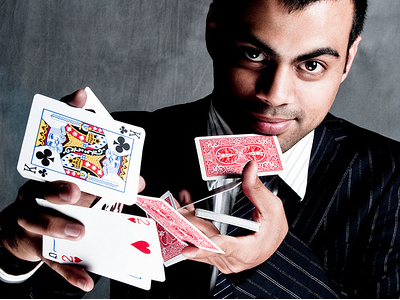 Magician showing a card trick illusion