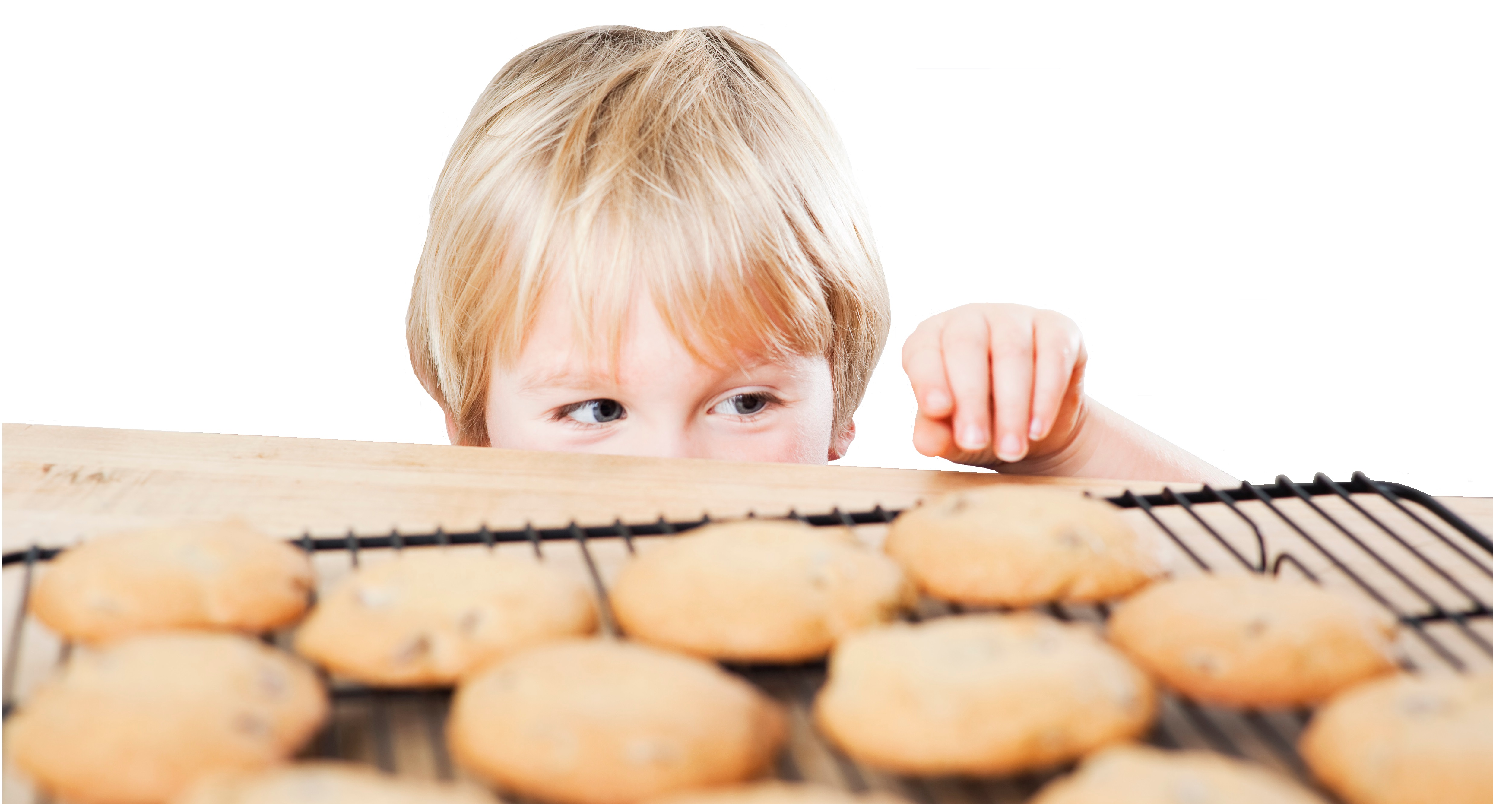 Boy eyeing freshly baked cookies