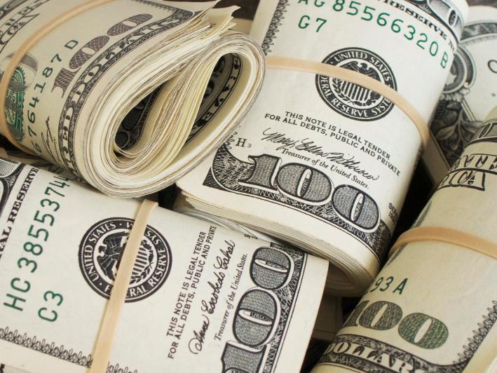 Fundraiser money collection bundles of $100 bills