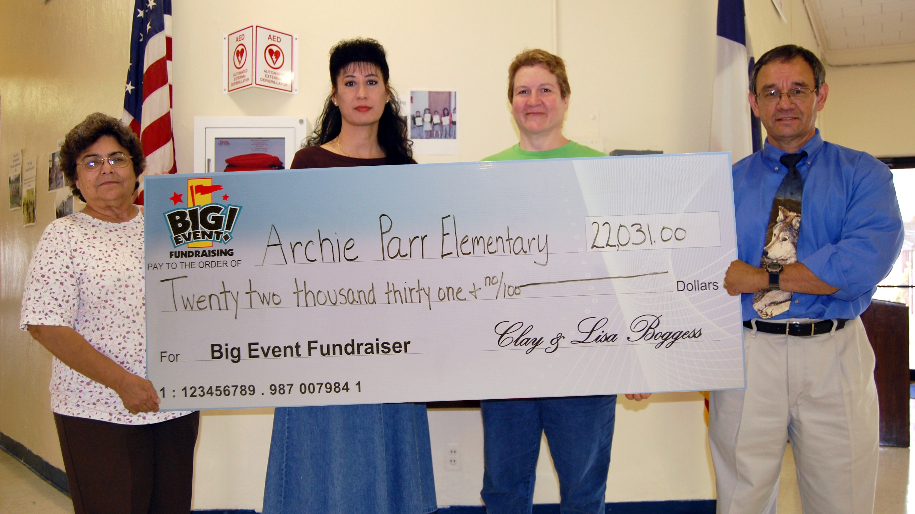 Archie Parr Elementary School fundraising team holding check