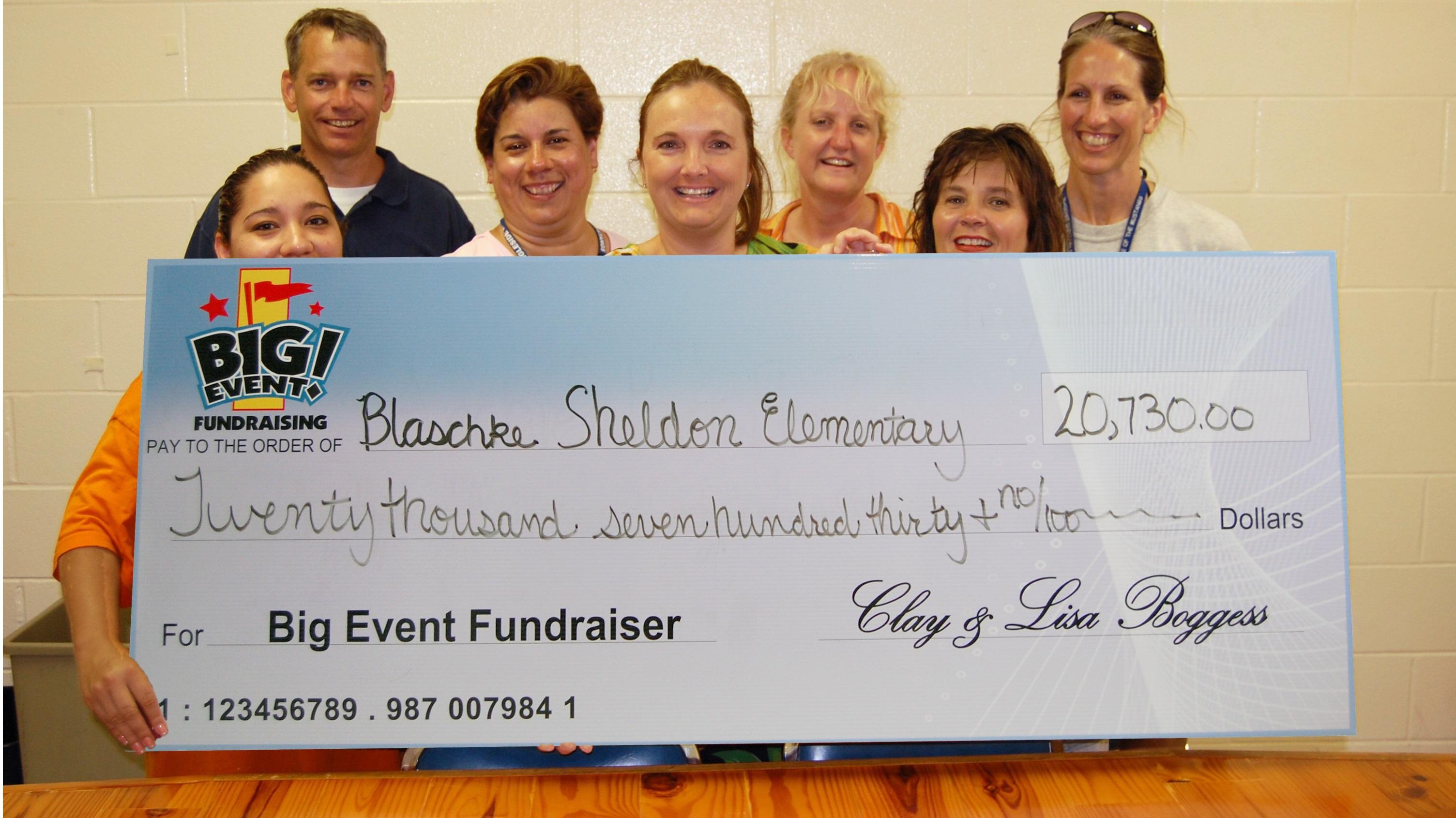 Blaschke Sheldon Estates Elementary School fundraising team holding check