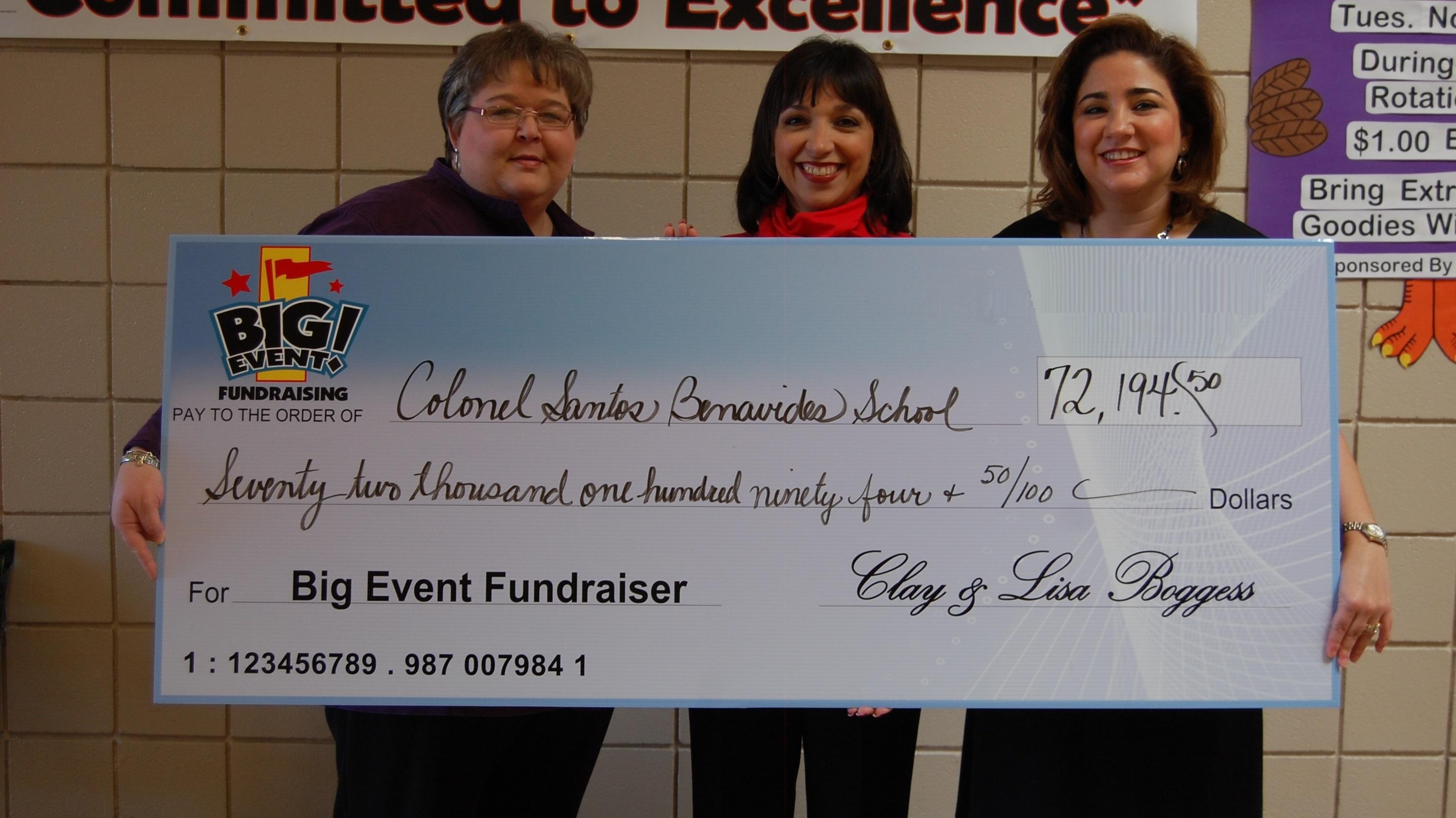 Col. Santos Benavides School fundraising team holding check