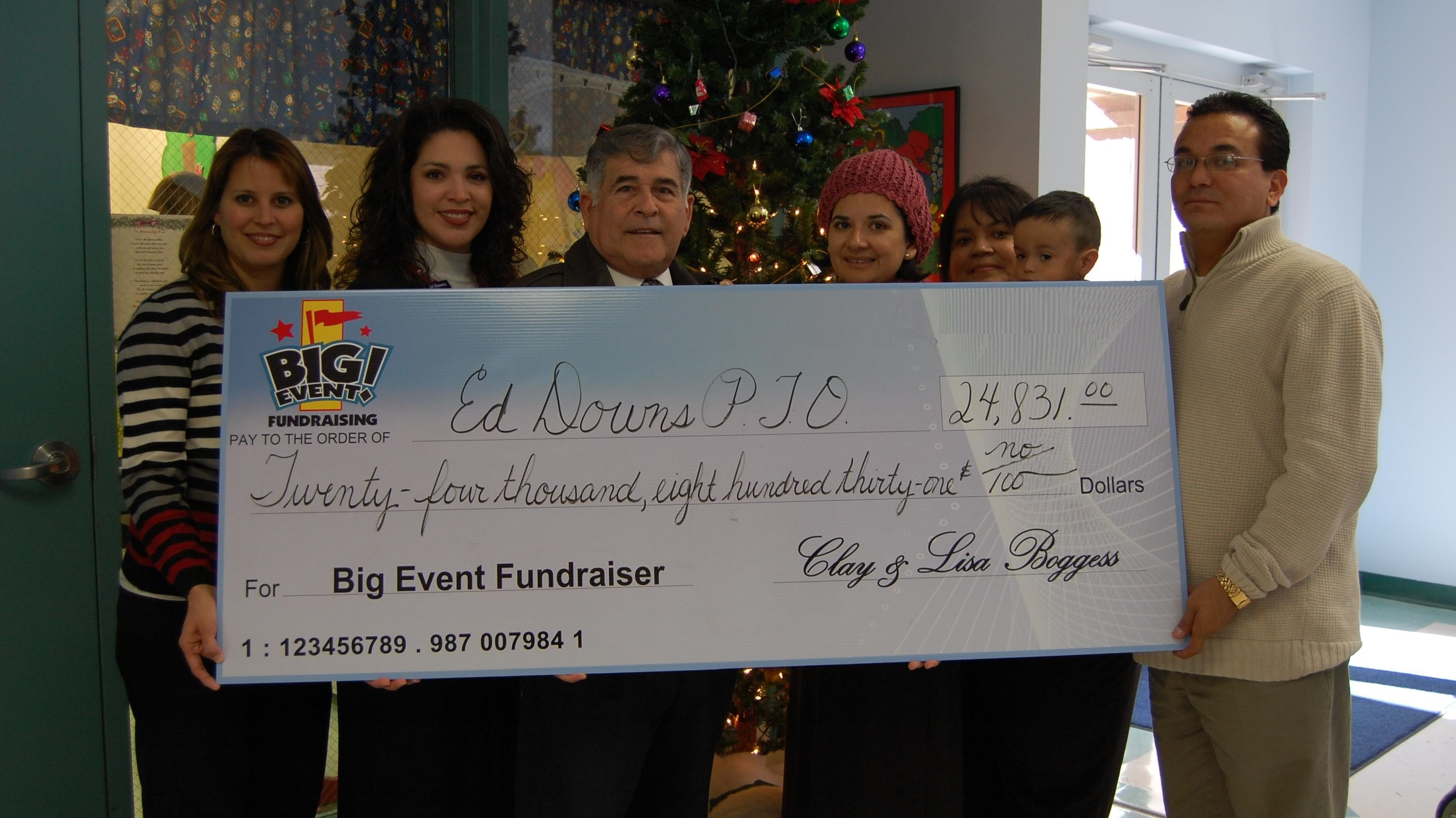 Ed Downs Elementary School PTO fundraising team holding check