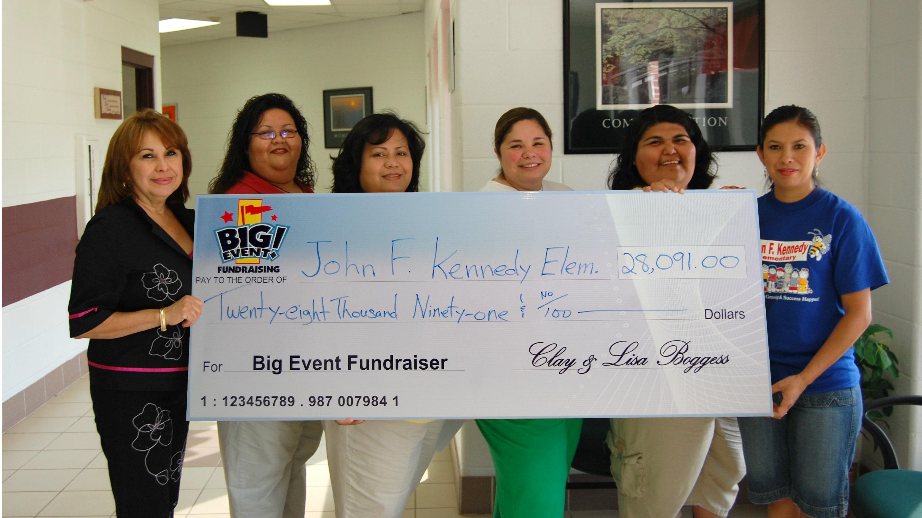 John F. Kennedy Elementary School fundraising team holding check