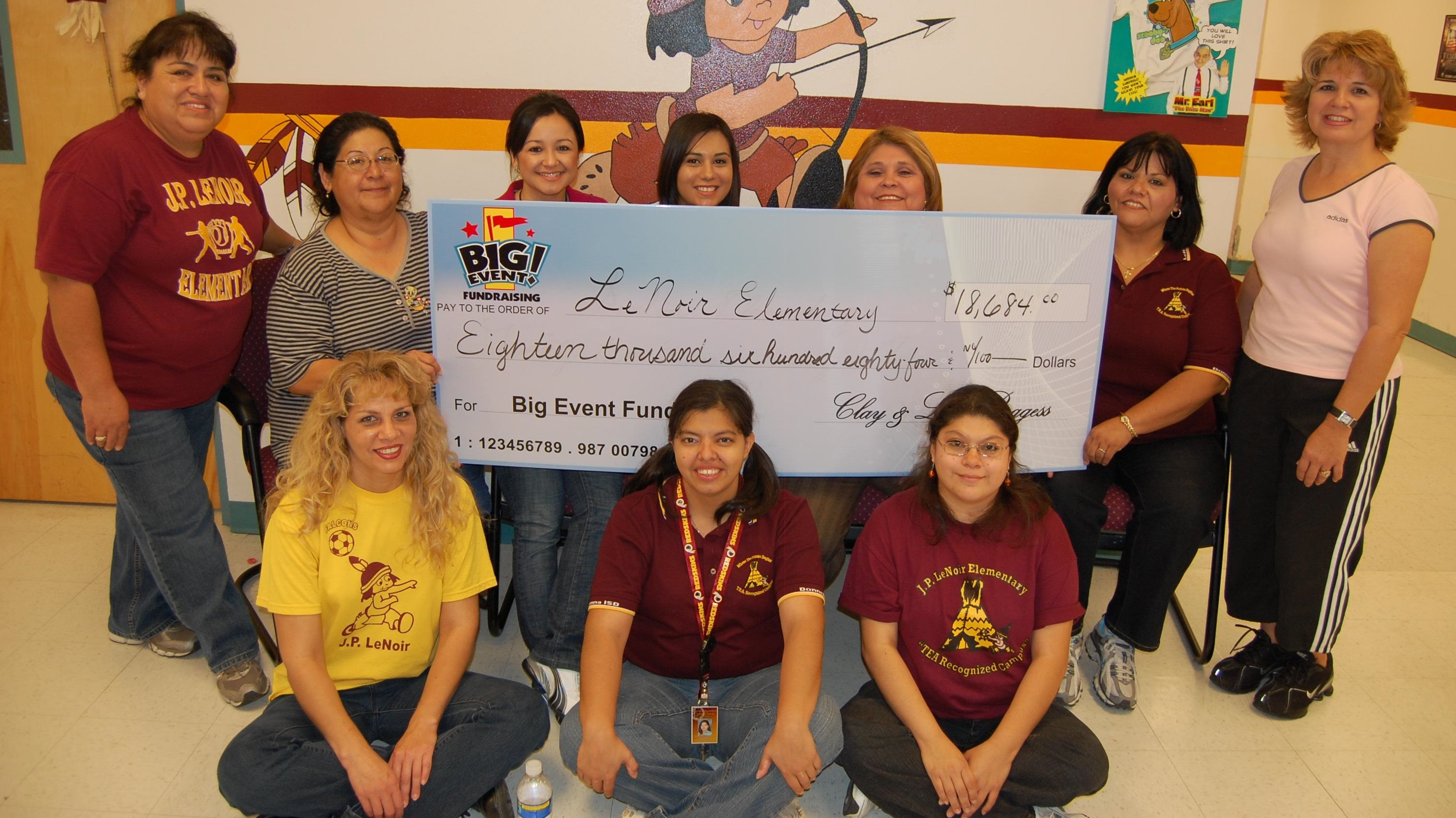 Le Noir Elementary School fundraising team holding check