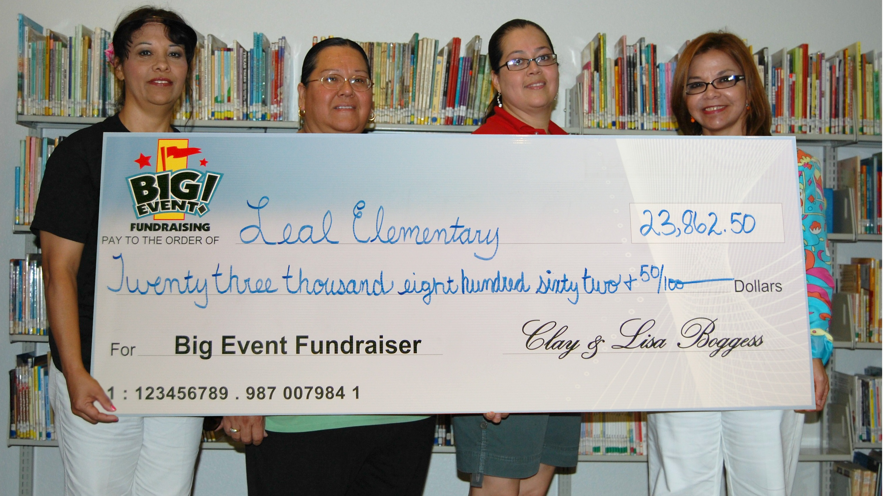 Leal Elementary School fundraising team holding check