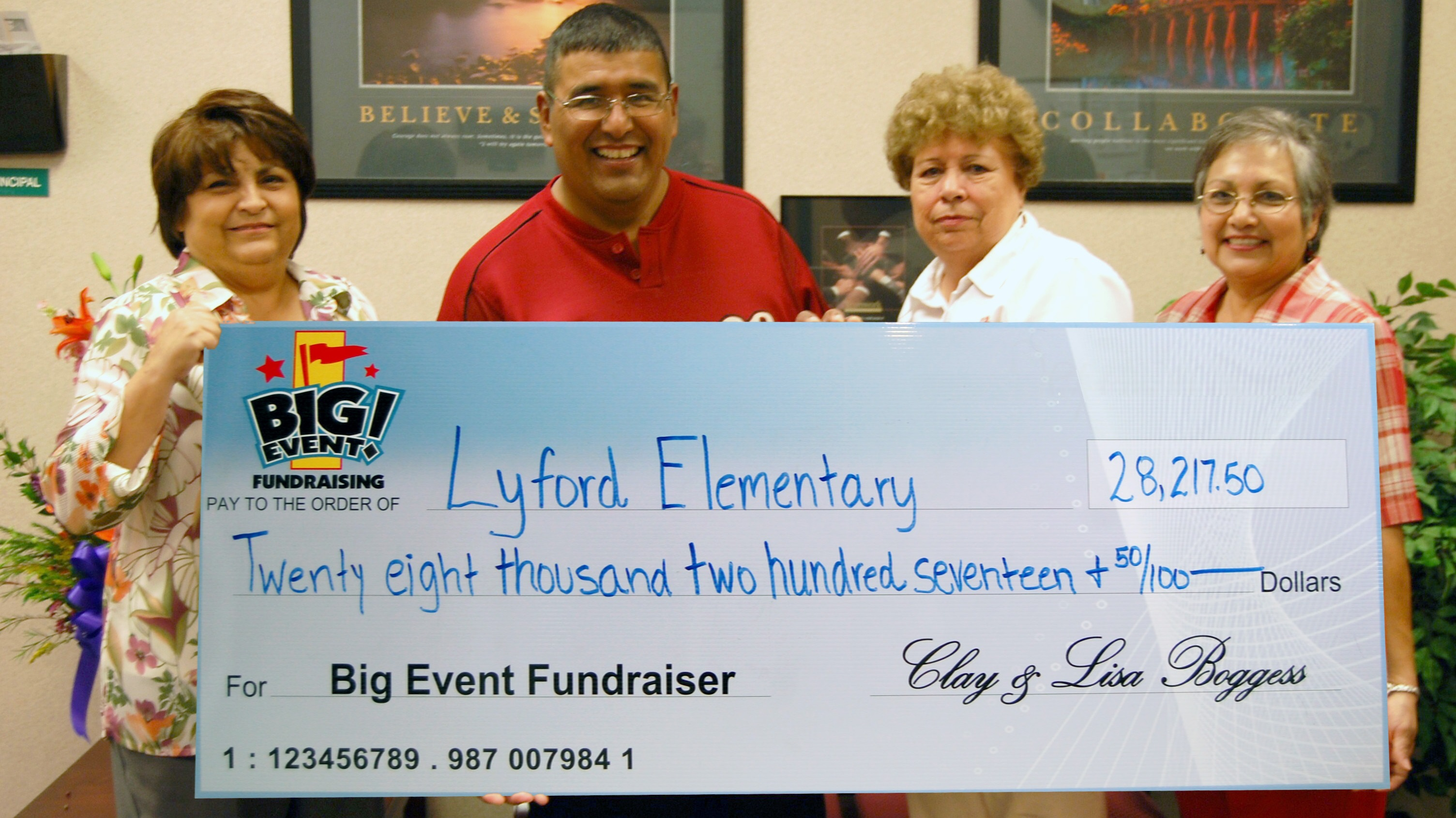 Lyford Elementary School fundraising team holding check