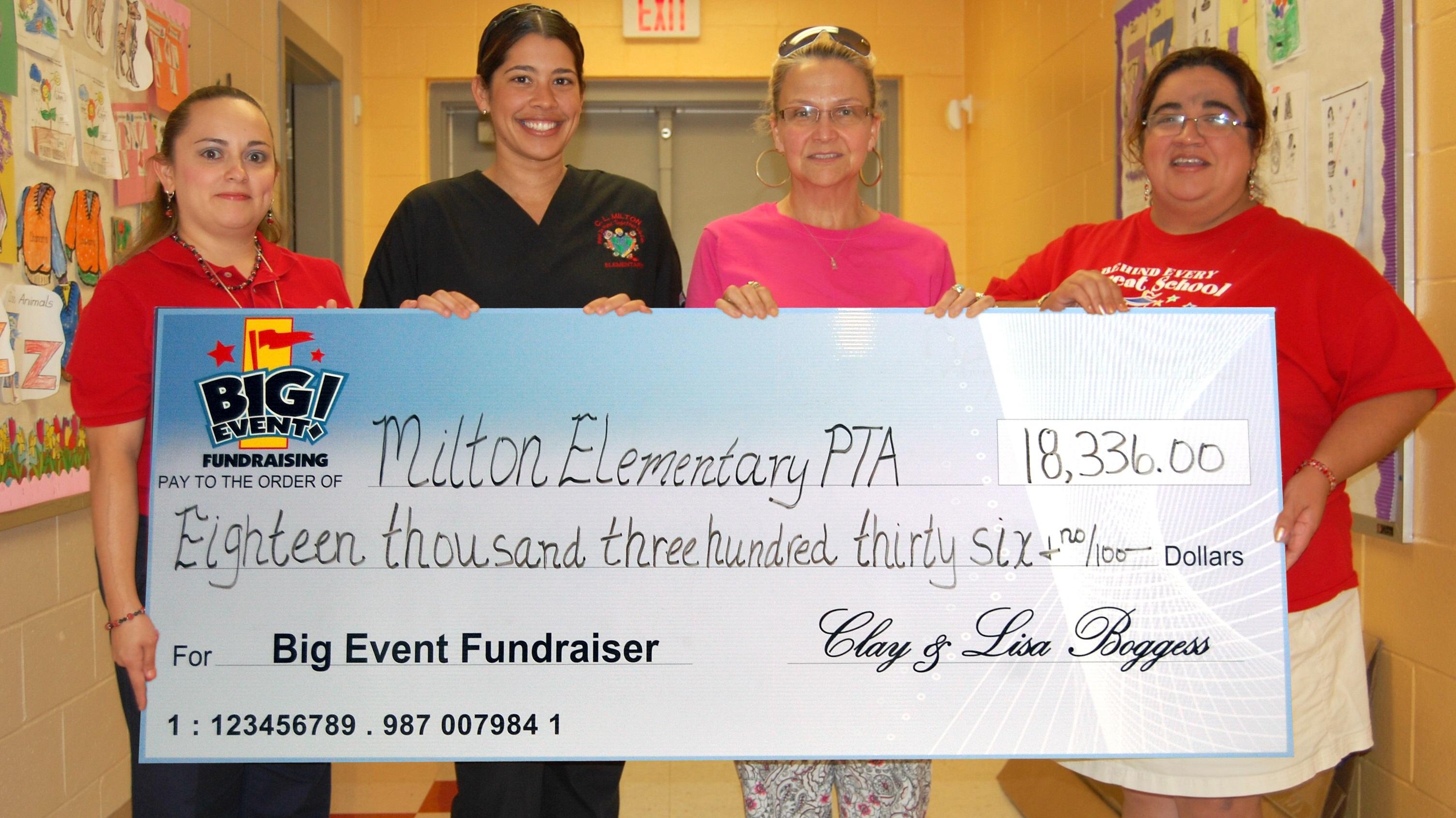 Milton Elementary School PTA fundraising team holding check