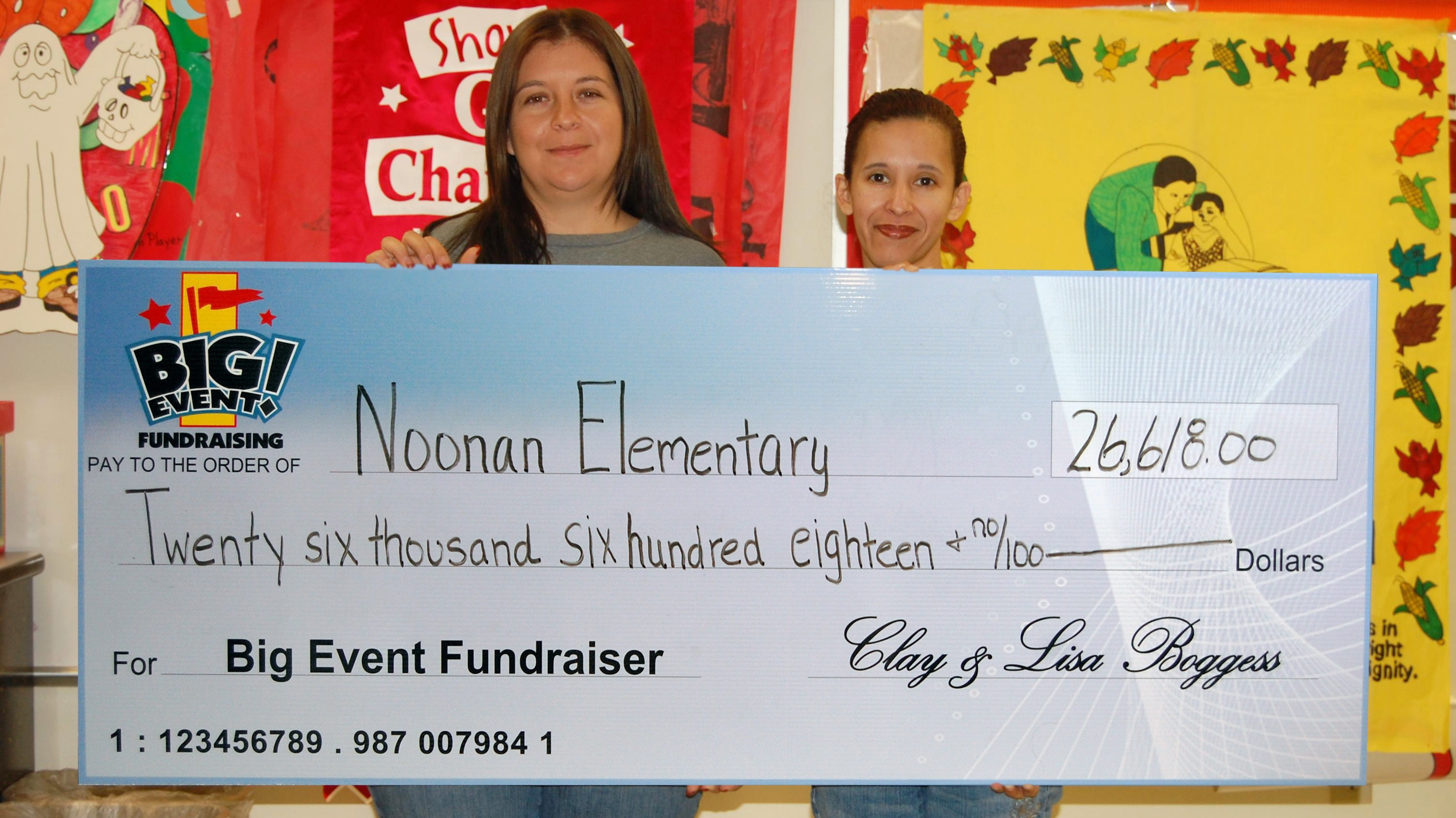 Noonan Elementary School sponsors holding large fundraising check