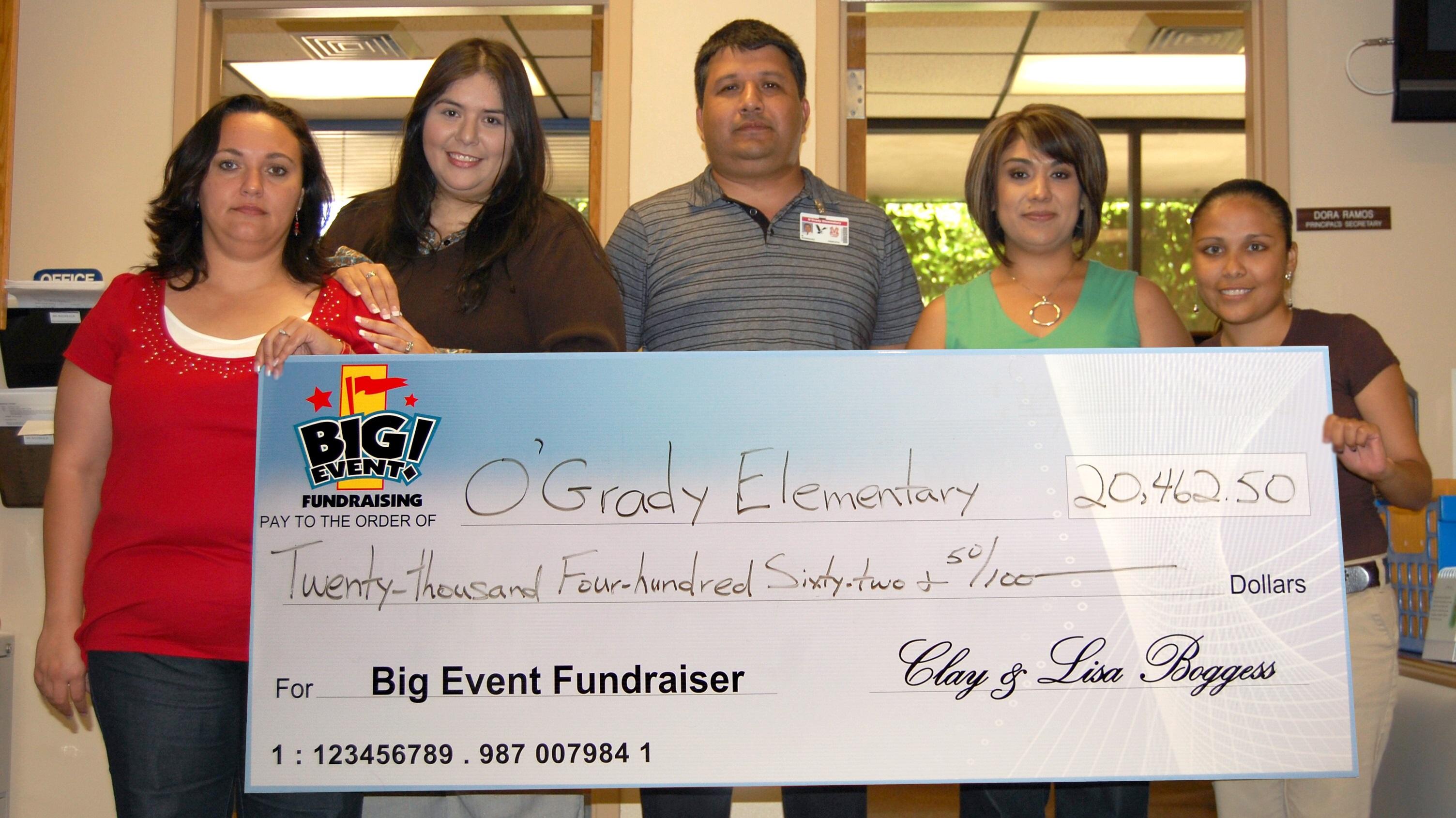 O'Grady Elementary School fundraising team holding check