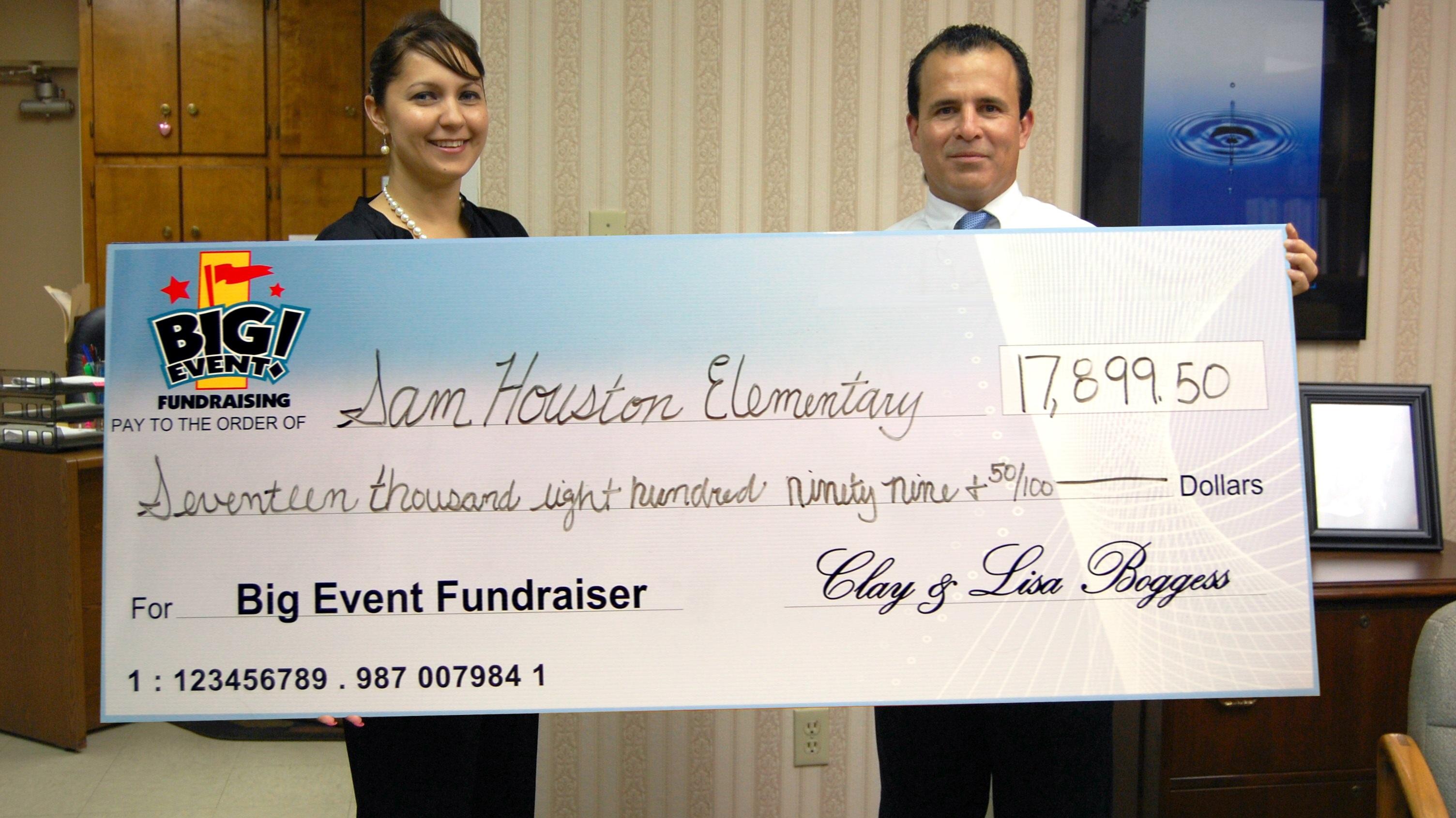 Sam Houston Elementary School fundraising team holding check