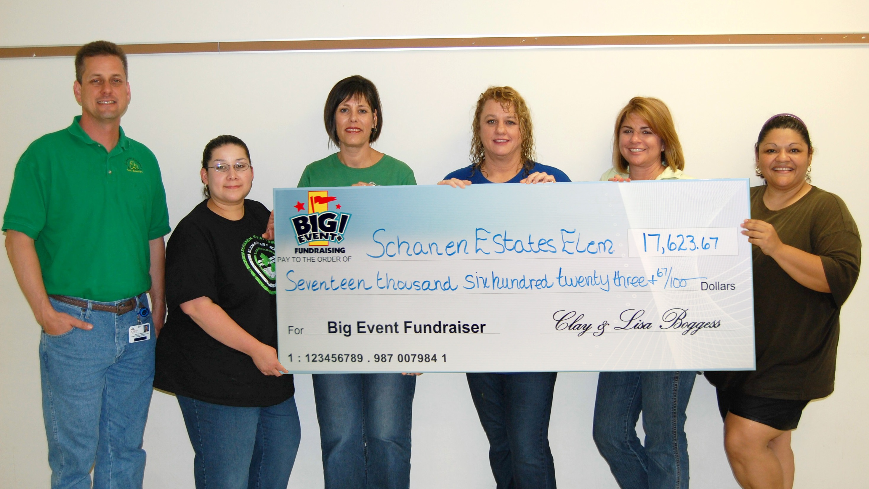 Schanen Estates Elementary School fundraising team holding check