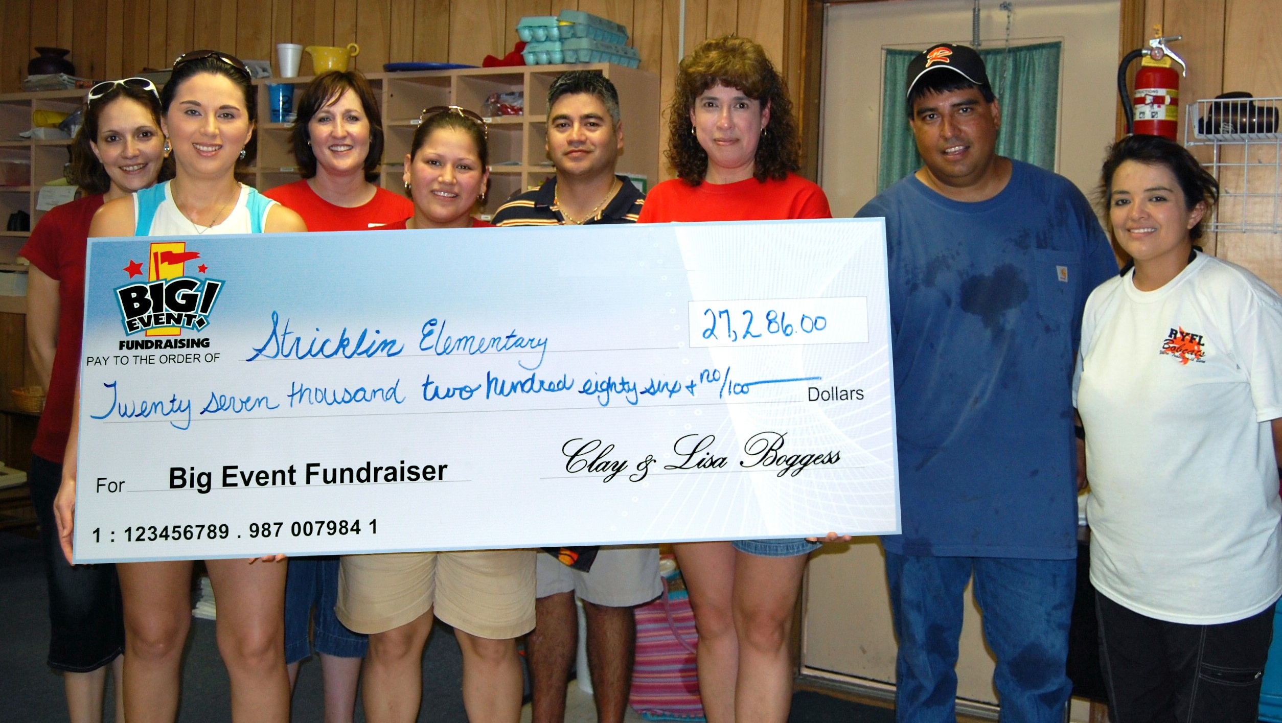 Refugio Elementary School fundraising team holding check
