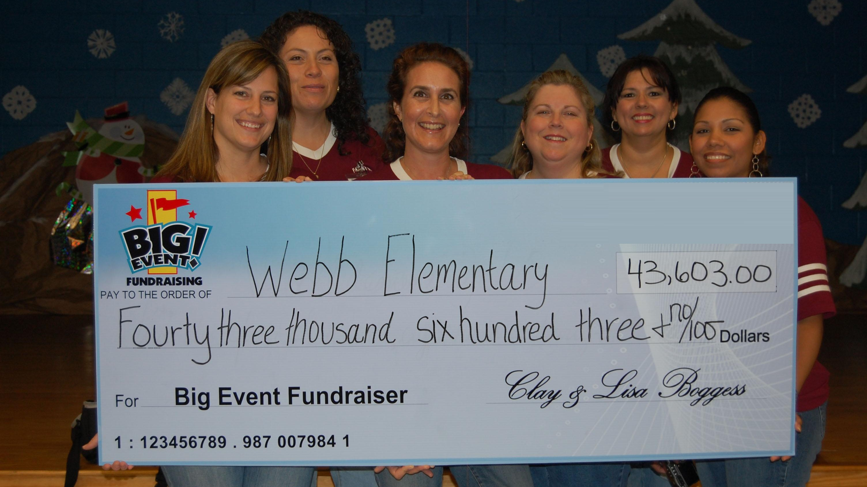 Webb Elementary School fundraising team holding check
