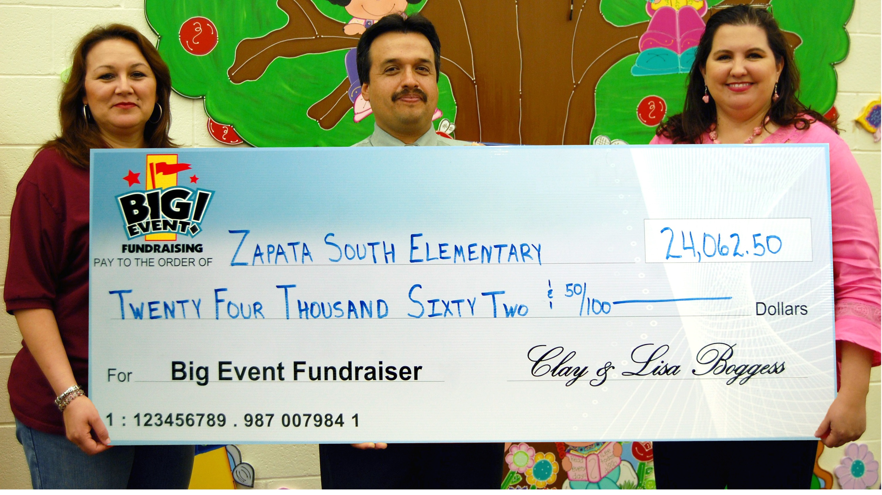Zapata South Elementary School fundraising team holding check