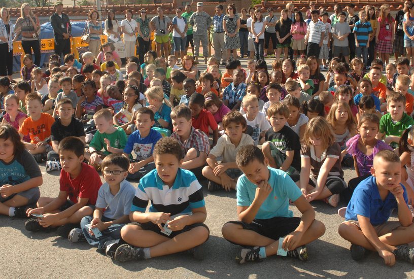 Student audience at outdoor promotional school fundraising assembly