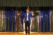 Magic show performer at an assembly