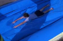 Student on slip n slide at super splash party event