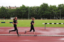 High school girls running on a track