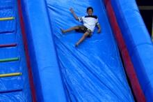 Student on giant slide at super party event