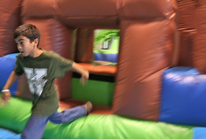 Super party visual promotional video showing student on obstacle course